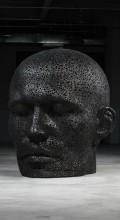 голова мужчины из велосипедной цепи