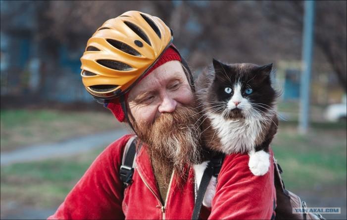 велосипедист с котэ